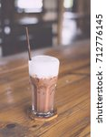 iced chocolate topped with coco ... | Shutterstock . vector #712776145