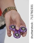 Small photo of Popular fidget spinner toy that is the latest fad
