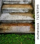 wet stairs in rain with green... | Shutterstock . vector #712787395