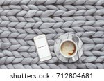 coffee and smartphone on... | Shutterstock . vector #712804681