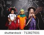 happy friends wearing halloween ... | Shutterstock . vector #712827031
