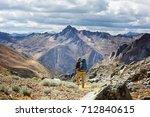 hiking scene in cordillera... | Shutterstock . vector #712840615