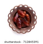 plate of pitted dates isolated... | Shutterstock . vector #712845391