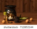 aroma lamp with burning candle. ...   Shutterstock . vector #712852144