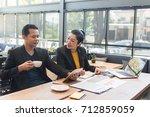 boss with women secretary busy... | Shutterstock . vector #712859059