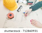 architect drawing on a... | Shutterstock . vector #712860931