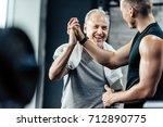 senior sportsman giving... | Shutterstock . vector #712890775