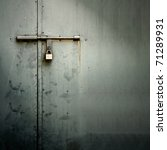 Closeup metal door with lock in grungy style and good texture. - stock photo