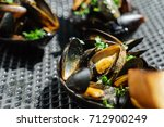 grilled mussels | Shutterstock . vector #712900249