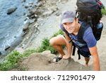 man traveler with backpack...   Shutterstock . vector #712901479