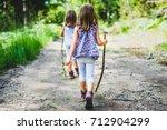 children   identical twins... | Shutterstock . vector #712904299