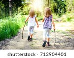 children   twin girls are... | Shutterstock . vector #712904401