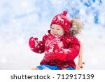 little girl enjoying a sleigh... | Shutterstock . vector #712917139