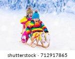 little girl and boy enjoying... | Shutterstock . vector #712917865
