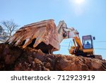 construction excavator with... | Shutterstock . vector #712923919