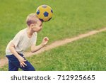 blond boy in white t shirt... | Shutterstock . vector #712925665