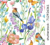 Stock photo seamless pattern for print on fabric wallpaper floral background of iris flowers the birds the 712926361