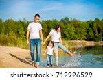 happy family walks on the... | Shutterstock . vector #712926529
