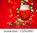full snifter glass of lager of... | Shutterstock . vector #712933987