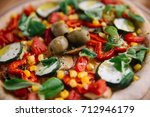 vegan pizza  close up | Shutterstock . vector #712946179