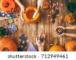 happy halloween  a mother ... | Shutterstock . vector #712949461