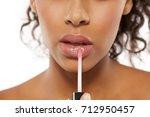 young beautiful black woman... | Shutterstock . vector #712950457