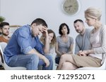 anxious man holding his head... | Shutterstock . vector #712952071