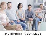 caucasian woman talking to...   Shutterstock . vector #712952131