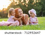 mom with two daughters sitting... | Shutterstock . vector #712952647