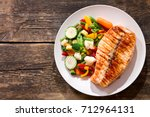 plate of grilled salmon steak... | Shutterstock . vector #712964131
