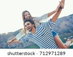 young beautiful tourist couple... | Shutterstock . vector #712971289
