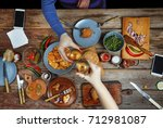 meeting friends at the dinner... | Shutterstock . vector #712981087