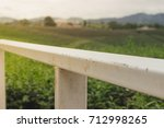 white iron rail for sitting and ... | Shutterstock . vector #712998265