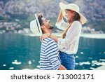 Stock photo couple in love enjoying the summer time by the sea 713002171