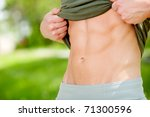 sexy man showing his six packs... | Shutterstock . vector #71300596
