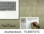 financial consultant helping hr ... | Shutterstock . vector #713007271