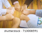 team touch hands together for... | Shutterstock . vector #713008591
