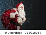 Santa Claus Holding A Bag With...
