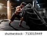 shirtless man flipping heavy... | Shutterstock . vector #713015449