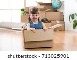 just moved into a new home. kid ... | Shutterstock . vector #713025901