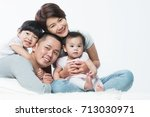 young happy asian family with... | Shutterstock . vector #713030971