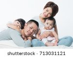 young happy asian family with... | Shutterstock . vector #713031121