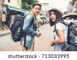 asian couple tourist... | Shutterstock . vector #713033995