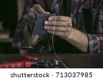 close up of man hand leather... | Shutterstock . vector #713037985
