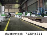 a long shop of a factory for... | Shutterstock . vector #713046811