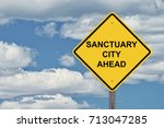 Small photo of Caution Sign Blue Sky Background - Sanctuary City Ahead