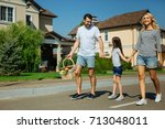 pleasant cheerful family going...   Shutterstock . vector #713048011