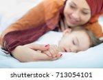 beautiful muslim woman | Shutterstock . vector #713054101