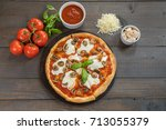 fresh hot pizza on wood table... | Shutterstock . vector #713055379