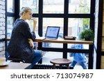 pondering attractive blonde... | Shutterstock . vector #713074987